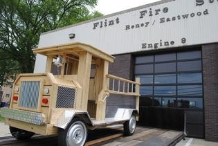 Diman students helped to rebuild a wooden fire truck that rested for years in front of the Flint St