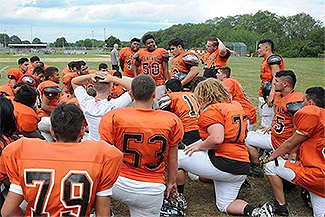 Members of the Diman football team gather after a practice earlier this year (Herald News file phot