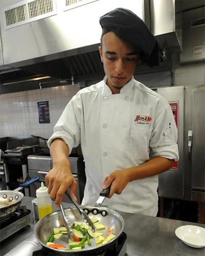 Culinary student Andrew Leger gets part of an order completed in a hot kitchen at Diman [ HN | Dave Souza ]