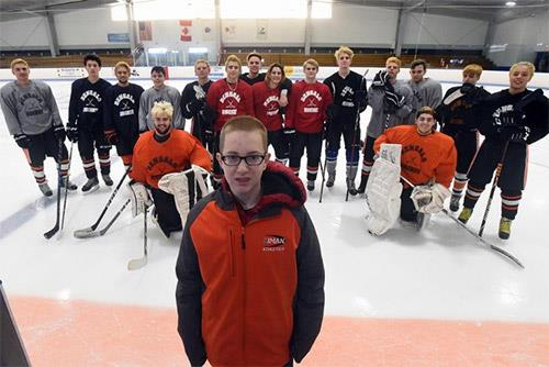 Diman hockey student-coach Matty Carpenter with his team during a practice session at Driscoll Arena [Herald News Photo | Dav