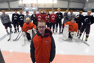 Diman hockey student-coach Matty Carpenter with his team during a practice session at Driscoll Aren