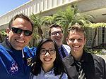 Students pose with an astronaut