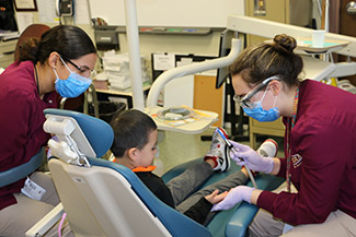 A student in a dentist's chair