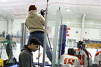 Students filming a hockey game