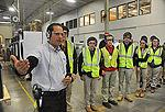 Raul Ricon gives Diman Regional students a tour of the Whirlpool plant in Fall River.  Herald News p